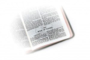 5214203-holy-bible-open-to-the-book-of-daniel-with-white-vignette-giving-the-image-a-clean-heavenly-feel