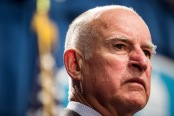 California Governor Brown looks on during a news conference at the State Capitol in Sacramento